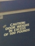A bathroom door with this warning would also be an inconvenient addition to any hotel.